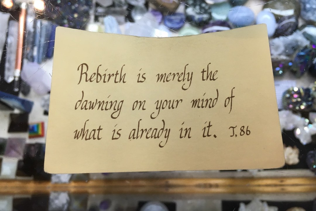Slip of paper reading Rebirth is merely the dawning on your mind of what is already in it